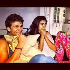 Keegan Allen and Shay Mitchell watching Pretty Little Liars. This is what I do everytime I watch pll on Tuesday!!