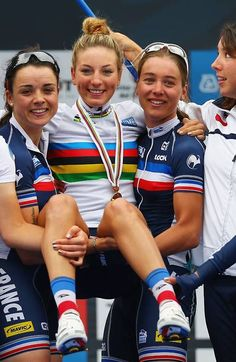 PONFERRADA, SPAIN - SEPTEMBER 27, Pauline Ferrand-Prevot of France poses with her team mates after winning the Women's Elite Road Race on day six of the UCI Road World Championships on September 27, 2014 in Ponferrada, Spai
