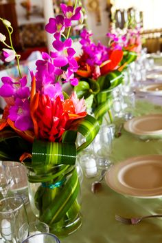 Are you having your wedding in a tropical area? You need to choose the best tropical wedding flowers for your special day. They should withstand the heat and humidity to avoid withering before the day's events are completed. Tropical Wedding Centerpieces, Tropical Flower Arrangements, Bridal Shower Centerpieces, Floral Centerpieces, Tropical Flowers, Wedding Decorations, Bright Flowers, Bright Purple, Purple Flowers