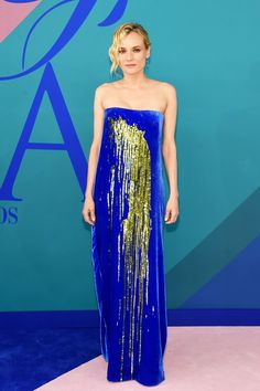 Diane Kruger was SO chic in this strapless blue gown with sequin embellishments by Monse at the CFDA awards this evening