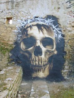 Skull street art by Cart1