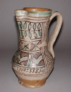 Medieval maiolica jug from Umbria, Itay. Even though this ceramic piece is from the 1300s, its chevrons and mix of patterns have a modern feel. Via Fitzwilliam Museum