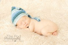 sleeping-newborn-baby-with blue-striped-hat