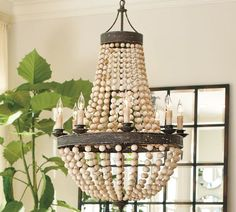 Could easily do this with my kitchen chandelier - same bones! Wood beads. Compare to pottery barn $499 fixture!