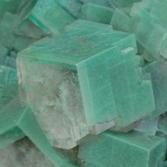 Calcite with gorgeous green glow caused by the inclusion of micro Dioptase. From Tsumeb Mine, Tsumeb, Otjikoto Region, Namibia