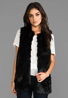 It's winter - and we love to snuggle up and layer up.  Try layering a fur vest with your ensemble for an oh-so-touchable date look.
