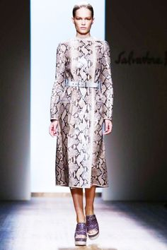 """Salvatore Ferragamo Photo Courtesy of Ferragamo """"The midi length and long sleeves of this snakeskin dress keep it simple and sleek while the platform wedge adds a whimsical twist. This look encapsulates Italian chic."""""""