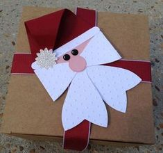 Embalagem Papaei Noel - Gift Bow Santa by Amber - Cards and Paper Crafts at Splitcoaststampers Noel Christmas, Christmas Paper, Christmas Ornaments, Christmas Punch, Christmas Ribbon, Father Christmas, Christmas Projects, Holiday Crafts, Holiday Fun