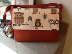 """""""I'm A Hoot!""""  This cute little messenger bag was a custom order for a young lady who loves owls!  Heavy canvas rust colored fabric accented with whimsical owls are sure to put a smile on your face!  Check out Bobbin My Thread on Facebook for more designs by Nena!"""