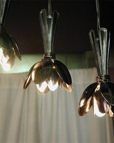Super cute blossom lights are made out of spoons.  Looking at them they look like they would be simple enough to make.