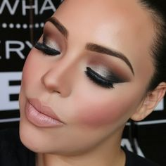 "1⃣Bobby Brown's ""Pewter"" on the lid. 2⃣Brown Script by Mac in the crease, winged out. 3⃣Carbon by Mac in the outer V also winged out. 4⃣with an Angled brush line the lower lash line. 5⃣Apply a black pencil or Gel Liner in the water line 6⃣Pink Swoon Blush by Mac 7⃣Harmony Blush as a Contour 8⃣Naked Lip Liner & Viva Glam V lipstick by Mac on the lips. 9⃣Lashes are Eyelure's 205"