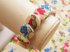 Fabric covered button bracelet using Dritz buttons