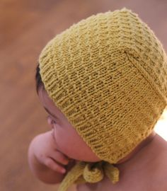 A timeless hand knitted baby bonnet.  This is a hand knitted baby bonnet in high quality, soft superwash merino wool. Available in four colors. (See photos) The Astrid bonnet is a unique Dreamiknit design, inspired by the clothing in Nordic childrens tales. The textured stitch pattern gives it a vintage feel. Pure merino wool warms on cold days and breathes on warmer days.  MATERIAL: merino wool is known for being the perfect baby wool. Its warm, super soft, non-itchy, and is even machine…