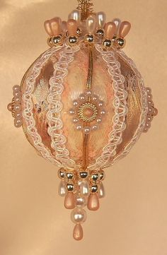 Victorian style Christmas ornament. One of my Mom's favourite crafts for us when I was little too.