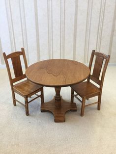 A Schilling - walnut table and chairs