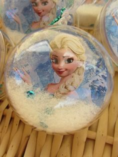 put image into ball and add snow fluff from pillow and blue snow flake paper punches- Frozen