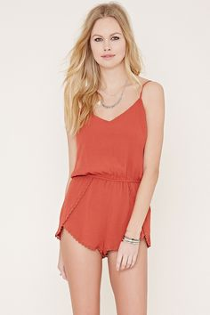 Style Deals - This crepe woven romper features adjustable cami straps, an elasticized waist, a crochet-trim dolphin hem, and a buttoned keyhole back.