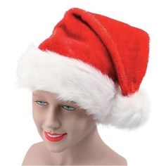 b4653ec2c031a Plush Santa hat with fluffy white trim and pom-pom. Perfect to be worn