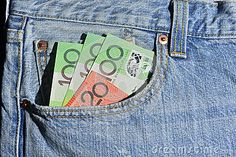 Australian money in the front pocket of a pair of jeans, 3 x $100 and 1 x $20.00 notes. Copyspace.