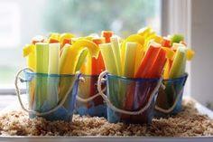 Beach Bucket Veggies with Ranch Dip - celery sticks, carrot sticks, and yellow pepper strips