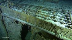 This picture displays a close-up of Titanic's well deck and forecastle (the forward part of the main deck). The open door leads to the lamp room where navigation lamps and hazardous fuels, such as kerosene, were kept. Navigation lamps were used to signal other ships about location.
