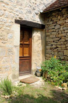 La petite maison haute :: small 17th century stone cottage in Dordogne, France :: glass door with interior wood shutters