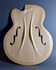 Archtop carve with integral carved bracing.