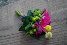(c) Signature Flowers by Emma Newman Pink gerbera buttonhole Purple pink and yellow wedding Wedding flowers Gerbera buttonhole Craspedia Waddesdon wedding