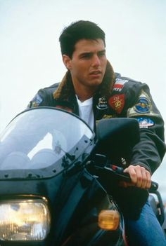 "THIS IS MAVERICK RIDING HIS MOTORCYCLE WHICH THEY SHOW HIM ALOT IN THE ""GREATEST MOVIE EVER"" AND THERE ARE SOME GREAT SCENES IN THE MOVIE WHICH MAVERICK IS ON HIS MOTORCYCLE!!"