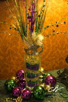 Mardi Gras centerpiece for the Work Party Dad made the stand, fleur de lys top .Mardi Gras centerpiece for the Work Party Dad made the stand, Fleur de Lys Topper is from Michaels. Mardi Gras Wreath, Mardi Gras Decorations, Mardi Gras Beads, Wedding Decorations, Mardi Gras Food, Mardi Gras Party, Carnival Centerpieces, 50th Birthday Party, Teen Birthday