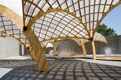 Beatfuse! canopy by OBRA Architects Polypropylene mesh allows wind and rain to move though it