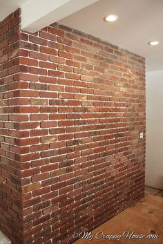 My Crappy House--- shows many do it yourself projects tackled by a single woman. Installing a brick wall. Fake Brick Wall, Brick In The Wall, Faux Brick, Exposed Brick, Brick Walls, Brick Veneer Wall, Wall Sheets, Brick Interior, Diy Interior
