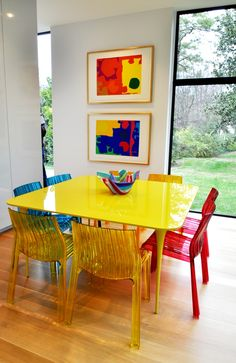 Dining room - Patricia Urquiola. I'm not a fan of plastic but the glass-like lucite chairs are beautiful