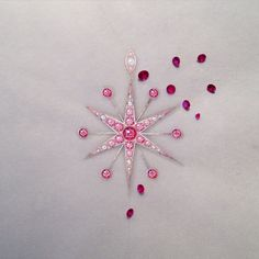 Design proposal for a star pendant set with rubies, pink sapphires and rubies, set in rose gold.