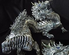 Tomisha needs to make for Randy  Dragon. Creative use of recycled soda can pull tabs glued together