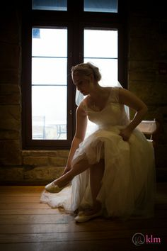 bride puts on shoes - Allison Peabody Hall - Abe Martin Lodge - Brown County State Park - KLM Photography