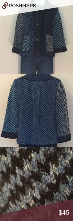 Anthropologie Curio Sweater This eccentric blue, grey and black Anthropologie Curio Sweater is made of 56% acrylic, 21% poly, 20% rayon and 3% wool. It features bell sleeves, large black buttons, a cowl neck with velvet ties and side pockets. This is such a great piece! 💕j Anthropologie Sweaters