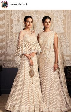 Delicately crafted in gossamer textiles, our exquisite evening wear ensembles in muted tones of ivory reflect the ease of great construction, sparkling diamantes and fine threadwork. Western Gown, Western Dresses, Indian Gowns, Indian Attire, Indian Wear, Pakistani Outfits, Indian Outfits, Indian Clothes, Party Wear Lehenga