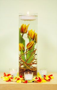 Submerged tulips with floating candle