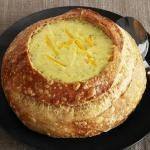 Broccoli Cheddar Soup - didn't check to see if this is a vegetarian recipe (if not, just substitute veg. broth for the chicken broth)... BUT I love soup served in bread bowls!