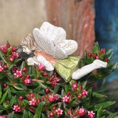 "Miniature Garden Fairy Mary Figurine Ornament by Fairies. $6.99. Fairies have learned that flying is an adventuresome way to enjoy the flowers of the garden. On a sunny day, Fairy Mary is busy flying in the garden and spreading pixie dust. The powers of the pixie dust bring magical blooms to all the plants. All the fairies in the garden will be able to enjoy the blooming plants. Fairy Mary comes with a 5"" pick, so it is easier to place her in many areas of the miniat..."
