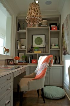 cosy small office space. Like the shelving design.