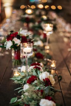 Head table garland with white and wine florals. Head table gar… Head table garland with white and wine florals. Head table gar… Head table garland with white and wine florals. Head table garland with white and wine florals. Christmas Wedding Themes, Winter Wedding Decorations, Red Wedding Centerpieces, Winter Wedding Ideas Diy, Red Table Decorations, Head Table Decor, Winter Centerpieces, Tall Centerpiece, Flower Centerpieces