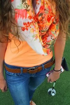blue jeans sleeveless shirt and floral scarf