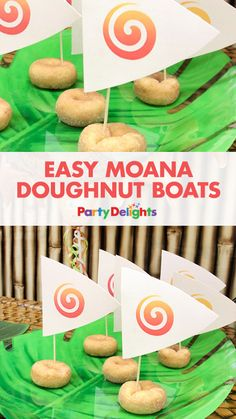 This is a super easy Moana party food idea! Download our free printable sails and use cocktail sticks to stick each one into a doughnut to make boats just like Moana's!