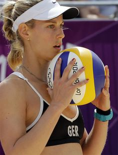 London Olympics Beach Volleyball Women    Sara Goller of Germany prepares to serve during a beach volleyball match against the Netherlands at the 2012 Summer Olympics