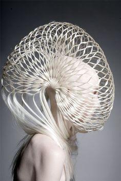 Nautilus sculptural shell hood, hair fashion.