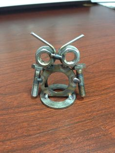 Owl I made for my girlfriend from nuts, bolts, washers, and tig welding rod