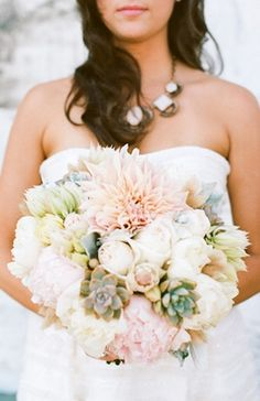 Bouquet with a frosty winter feeling, different white och pale pink flowers and the grey cute succulent echeveria.