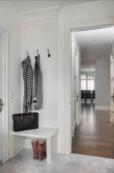Corner Crash Pad - If you ever thought a tiny corner couldn't have mudroom potential, this might change your mind. The little bench, painted in the same shade as the walls, blends in seamlessly. A beadboard background adds detail to the nook, with just enough space to keep a small amount of items organized.